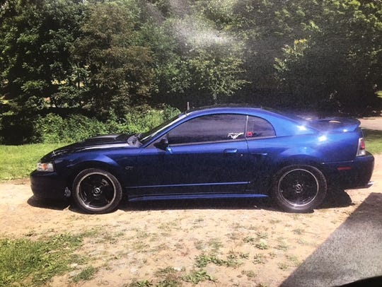 A blue 2001 Ford Mustang, which Haywood County Sheriff