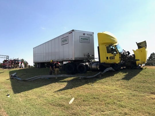 Wichita Falls Fire and Police departments work the scene of a HazMat injury accident in the 600 block of U.S. 287 northbound that sent one female to hospital with non life-threatening injuries. It was estimated that about 40 gallons of diesel poured out of one of the tractor trailer tanks.