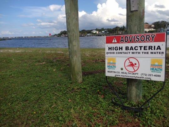 A sign at Sandsprit Park in Martin County asks visitors