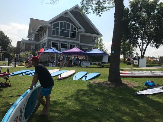 Paddleboards are lined up at the 2017 Midwest Stand Up Paddle Fest on Aug. 19, which was organized by the owners of Paddleboard Specialists, who have taken an interest in water conservation in Oconomowoc and Lake Country.