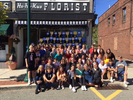 Students honor Glen Carullo outside Ho-Ho-Kus Flowers