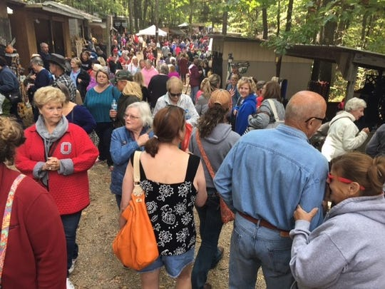 The Prairie Peddler festival on Ohio 97 outside Butler attracted a crowd of people Saturday. The event continues Sunday with crafts and more than 40 food vendors.