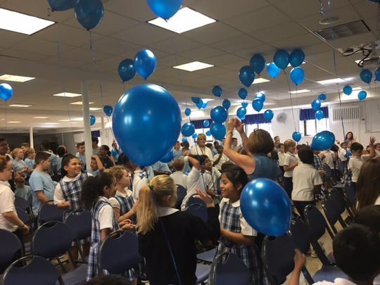 Verona students celebrate Our Lady of the Lake being named a National Blue Ribbon School of Excellence.