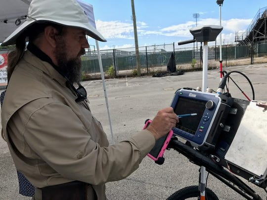 Duke Beasley, an archaeologist at the TennesseeValley Archaeological Research, shows off a ground-penetrating radar device that will be used at the site of Greer Stadium.