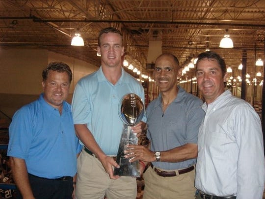 After the Colts' Super Bowl triumph, Manning brought the Lombardi Trophy to Indy's Reebok factory.