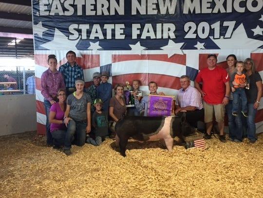 Dorian Cortese displays his grand champion swine after