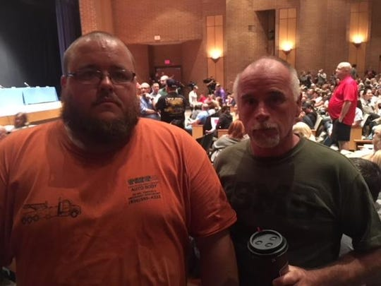 Joseph O'Donnell (left) and Kevin Reid (right) of Williamstown were among the many parents who attended Monday night's meeting at Williamstown High School regarding mold inspections at the township schools. All the district schools are closed this week after a bad mold issue was found at Holly Glen Elementary School.