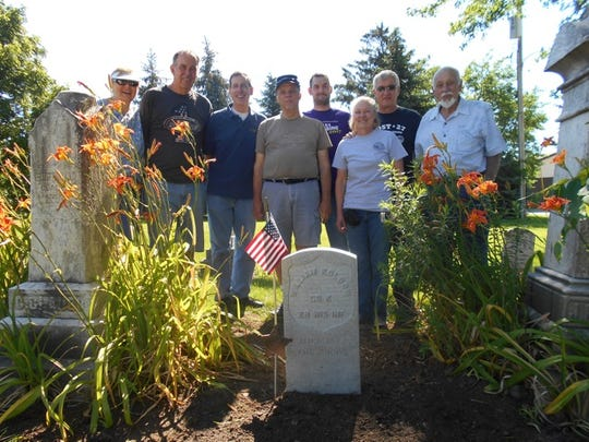 A group of people installed William Kolbow's tombstone in July. From left to right: Nancy Honadel, son Dean Honadel, Steve Michaels of Franklin, former national commander of the Sons; Tom Mueller of Oak Creek, former commander of Camp 1 of the Sons, Andrew Ludka, Marge Berres, Tom Ludka and Elroy Honadel.