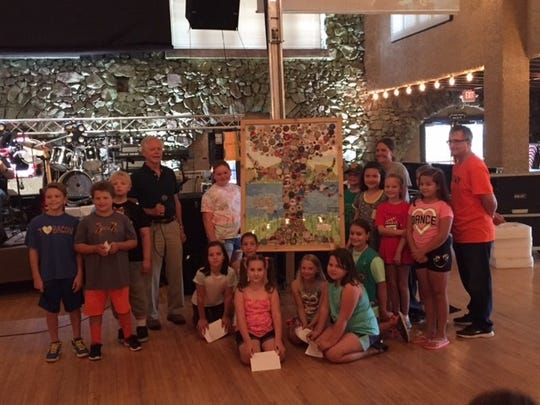 Evergreen Elementary students presented their artwork as a gift to the village of Rothschild.