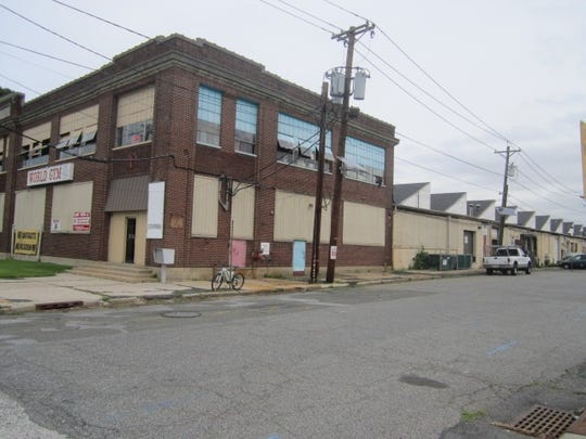 Redevelopment is planned for the Art Color factory site in Dunellen, next to the Raritan Valley commuter line.