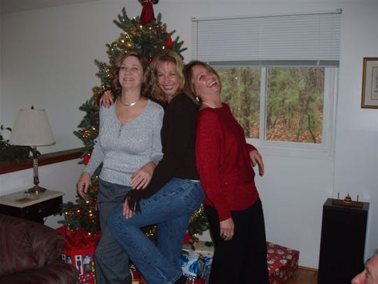 Diane, Kathyrn and Jaine goof around at Christmas.