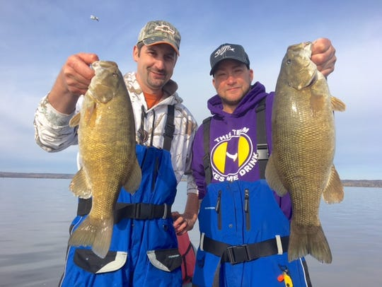Steve Leach and Jon Schlussler with a pair of big smallmouth