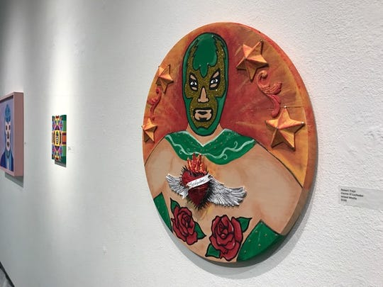 """""""Cosme El Luchador"""" by Robert Trejo is part of the Lucha Libre exhibition at K Space Contemporary during Dia de los Muertos."""