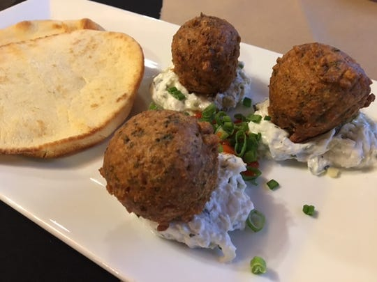 The Italian Bistro & Tap House includes unique tastes on the menu including falafel balls with a cucumber and mint yogurt sauce.