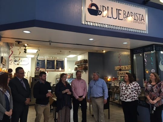 Steve and Lisa Beilstein and their son Andrew Beilstein, on Monday, center, with Richland Mall's Mark Weidemyre, officially opened The Blue Barista Coffee Shop Co. at the Richland Mall. Members of the Chamber and Ontario officials celebrated with a ribbon cutting. The Beilstein's said Weidemyre approached them about expanding their business into the mall. The Beilsteins also operate The Blueberry Patch on Hanley Road.