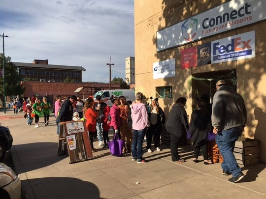The Downtown Trick-or-Treat event drew crowds early. Parents and strollers and trick-or-treaters began lining up 30 minutes before the 4 p.m. start, which would take revelers to dozens of downtown businesses in search of treats and door prizes. The event, hosted by the Odd Duck Coffee, continues to 7 p.m.