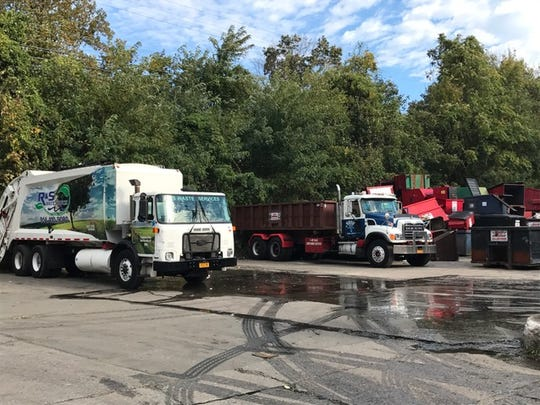 R & S Waste Services trucks and equipment are stored at a Mount Vernon property owned by another Joseph Spiezio company