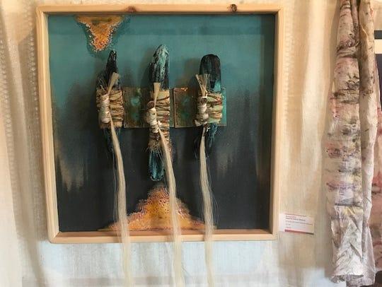 Encaustic work by artist Michael Billie is featured