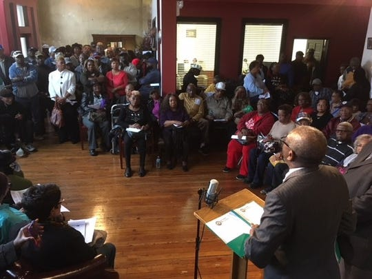 Pastor David A. Hall speaks to farmers and their families at the Black Farmers and Agriculturists Association offices in Memphis Monday, Nov. 6.