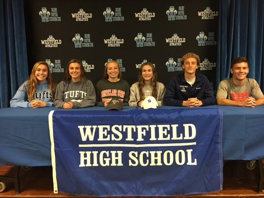Left to right: Westfield's Molly Ryan, Melina McDevitt, Kylinn Kraemer, Grace Elliott, Mark Walter and Dan Sokolin sign their National Letters of Intent on Wednesday.