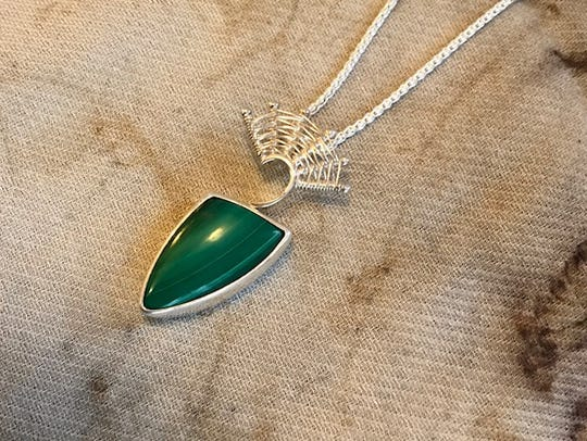 A malachite and sterling necklace donated by Marie
