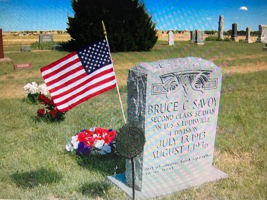 The cemetery stone in the photo commemorates Bruce