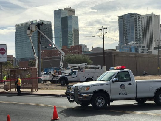 Crews work to repair a damaged power line at Third