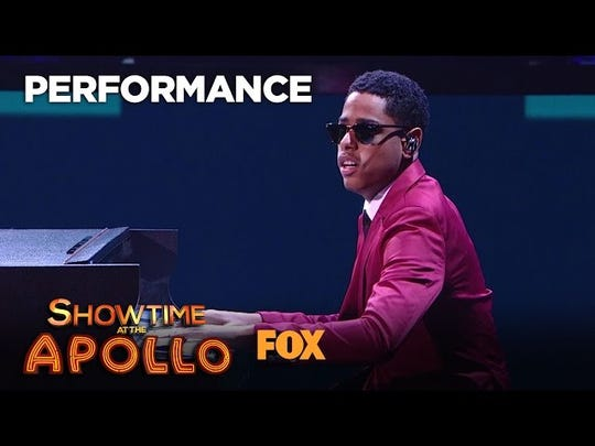 Matthew plays the piano at the Apollo.