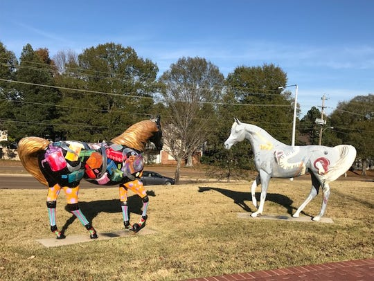 "Two horses — ""Gift Horse,"" left, and ""Rocking Horse"""