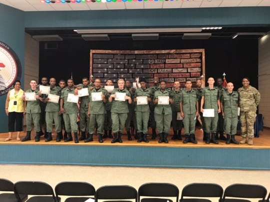 Delaware students in the 49th class of the National Guard Youth ChalleNGe Academy program graduate with both a high school diploma and GED.