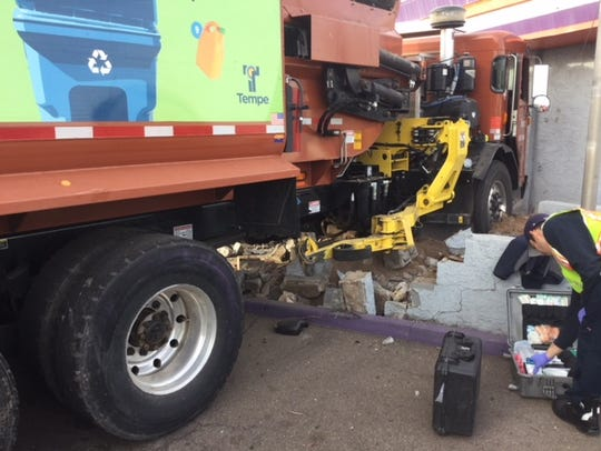 A city of Tempe garbage truck hit four cars at Seventh