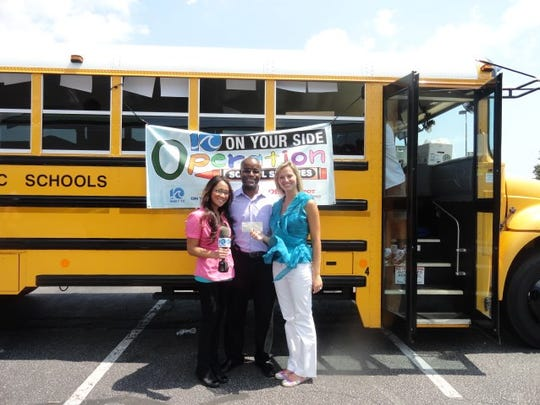 Susan Peterson (far right) holds a check from the Love Thy Neighbor Foundation, which was provided to Operation School Supplies in Virginia. Peterson is the daughter of John Davis, who began the Love Thy Neighbor Foundation and wants to use it to help families impacted by Hurricane Irma in Southwest Florida.