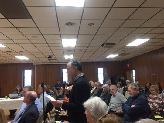 People pack the Rehoboth Beach Volunteer Fire Company hall to discuss the city's proposal to give LLC owners voting rights.