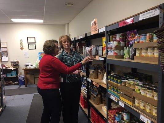 Rebecca-Owens-and-Karen-Amos-in-Catholic-Charities-food-pantry.jpg