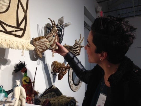 Jennifer McManus finds the faux taxidermy stuffed animals fascinating at the BBAC Holiday Show.