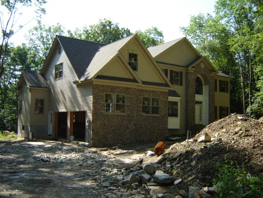 Two homes from the former Braemar at West Milford development