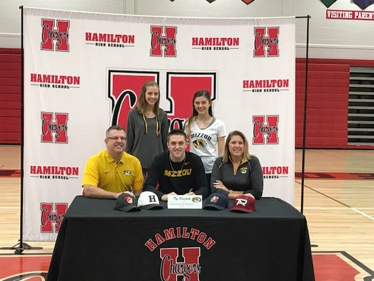 Ty Olejnik (center) signed his National Letter of Intent