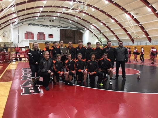 Members of the Marshfield wrestling team celebrated a team championship for the second year in a row at the Neenah Duals on Dec. 9 with an unbeaten run through five matches.