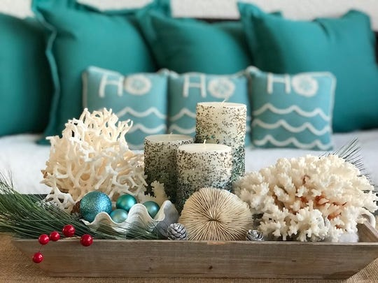 Claudine Auclair and Normand Giguere's beach-inspired Christmas decorations include starfish, seashells and coral.
