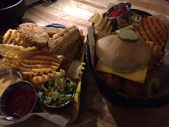Two items on the menu at Elkmont Exchange are fish and chips and a sandwich version of hot chicken.