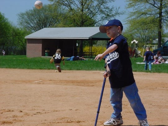 Chandler Warrick at age 6 in an adaptive baseball league