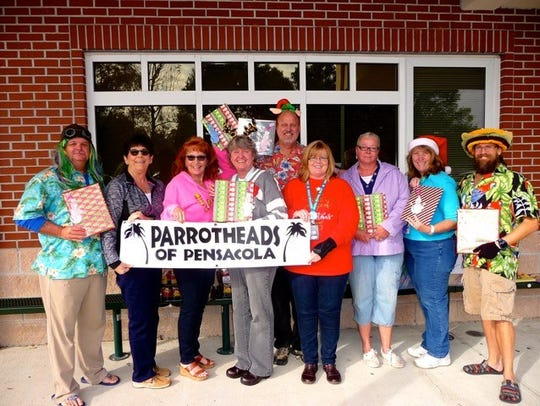 The Parrot Heads of Pensacola recently presented all