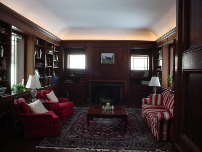 The home's library, with its wide hardwood floors and