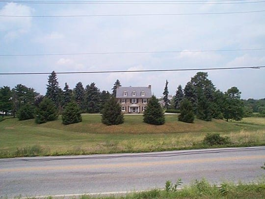 Picture of the house that sits on top of a mine waste