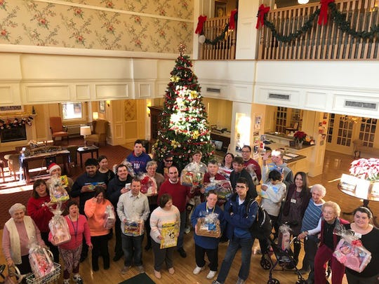 Group photo in the lobby of the Chelsea featuring Chelsea and Mt. Bethel Villageresidents, staff and families.