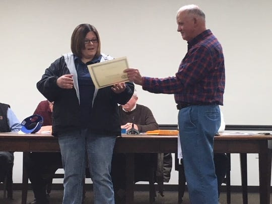 Dispatcher Megan Coker receives her certificate from Mayor Dickie Berry.