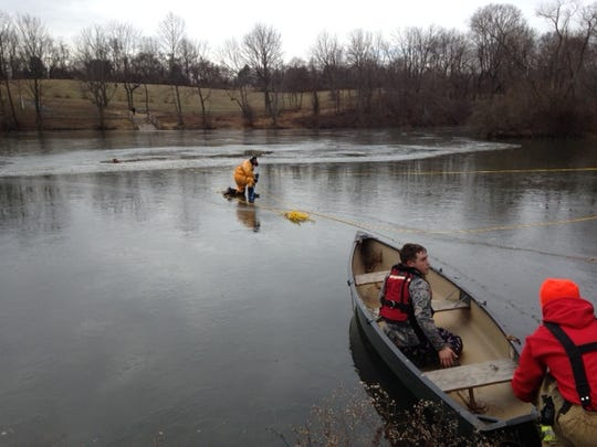 Firefighters rescue Uno Friday from an icy pond in Carousel Park.