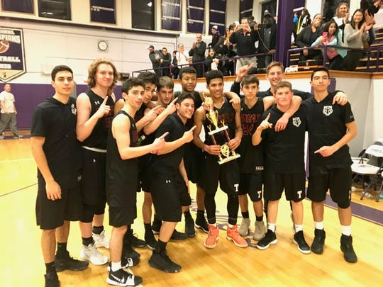 Tenafly celebrating with its trophy after winning the Garfield Holiday Tournament.