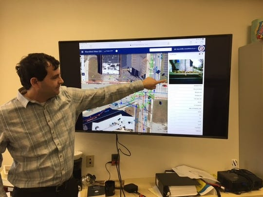 City engineer Bob Bianchi gives a demonstration of the new geographic information system the city is using to keep track of sanitary sewer, water and storm water systems.