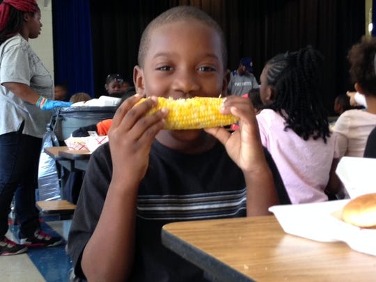 Hank Minniefield is a first- grader at Sabal Palm Elementary eating sweet corn from the New North Florida Co-Op in Marianna,